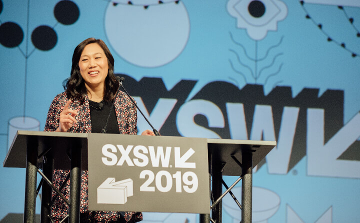 Priscilla Chan speaking at a lectern at SXSW