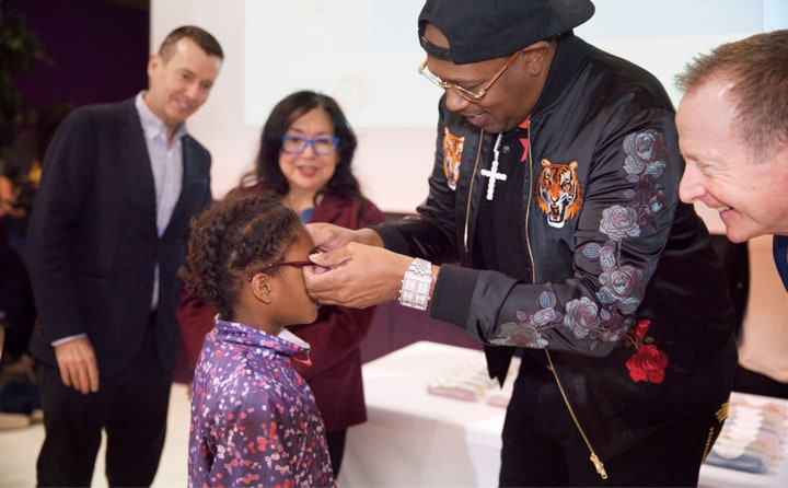 February 23, 2018 | Master P fitted a student with a pair of glasses at Vision to Learn's celebration event. Photograph by Gil Fortis