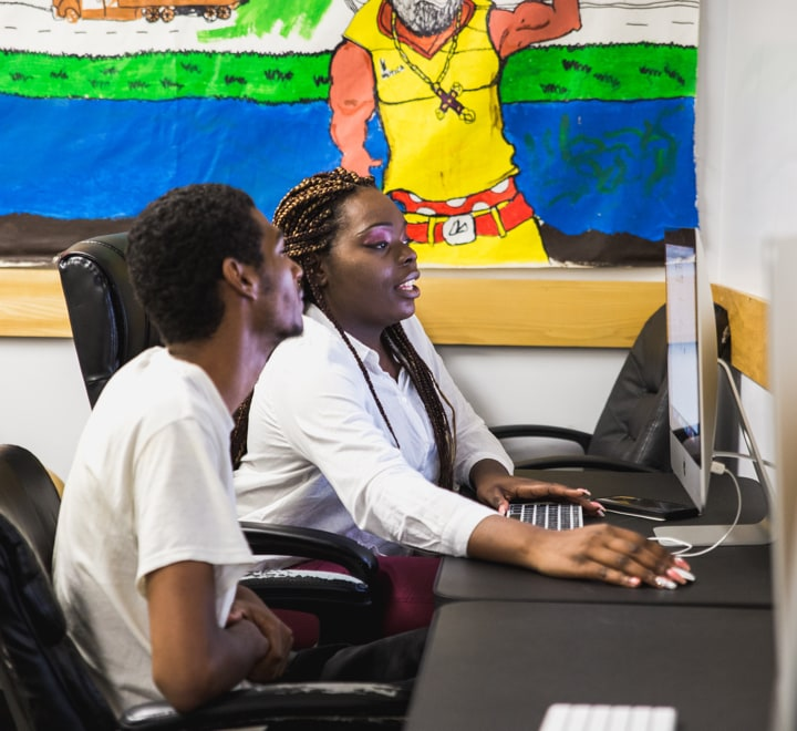 August 2, 2018 | Tarage Baker, staff member at BronxConnect worked with Lorenzo Bishop on his job applications. BronxConnect, a grantee of the Communities Thrive Challenge, runs alternative to incarceration, anti-gun violence, re-entry, and employment programs for young adults in the Bronx, New York. Photograph by Julian Bracero
