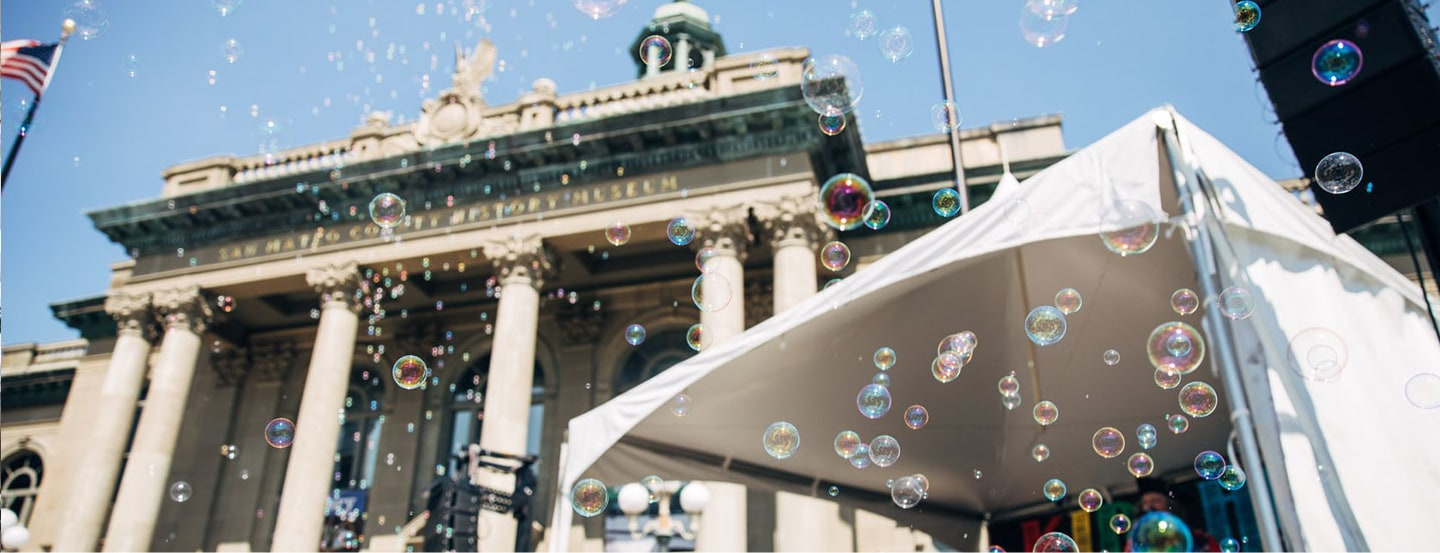 September 9, 2018 | Bubbles floating in front of the  San Mateo County History Museum in downtown Redwood City for Kidchella, a local event for families.