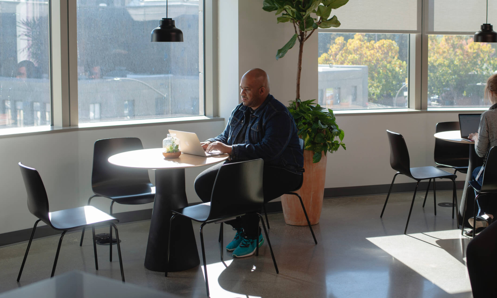 Maurice Wilkins, Diversity, Equity, and Inclusion Manager, in the library at CZI's office.