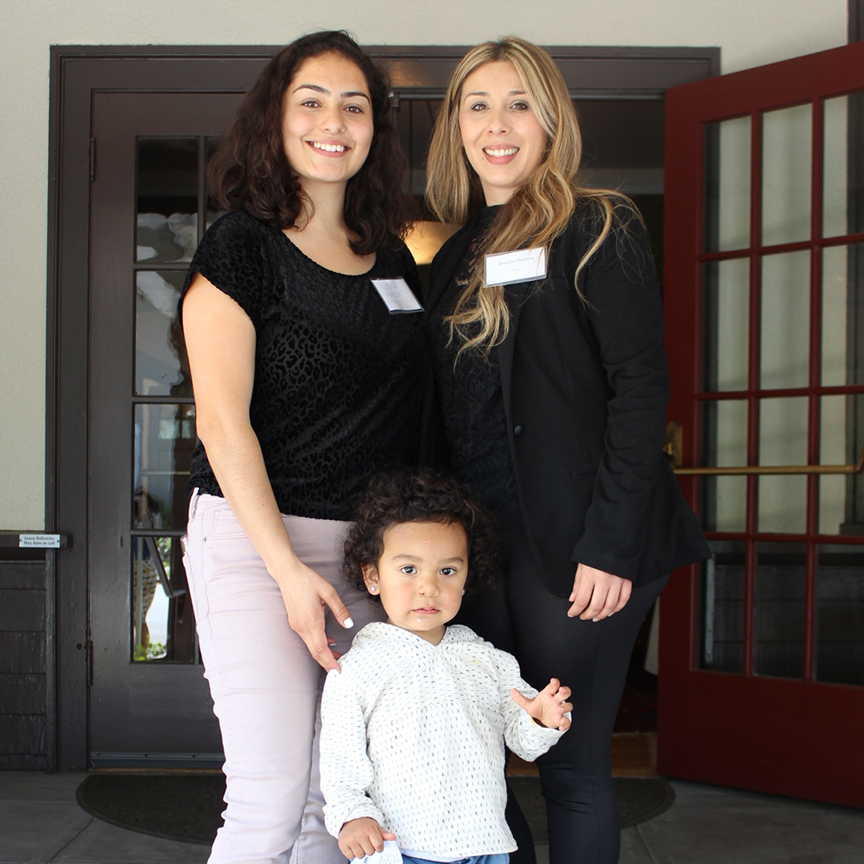 LiveAble graduate Nicole celebrates with her Able Works coach, Blanca Medina, and son, in East Palo Alto. The LiveAble program helps women achieve financial stability,