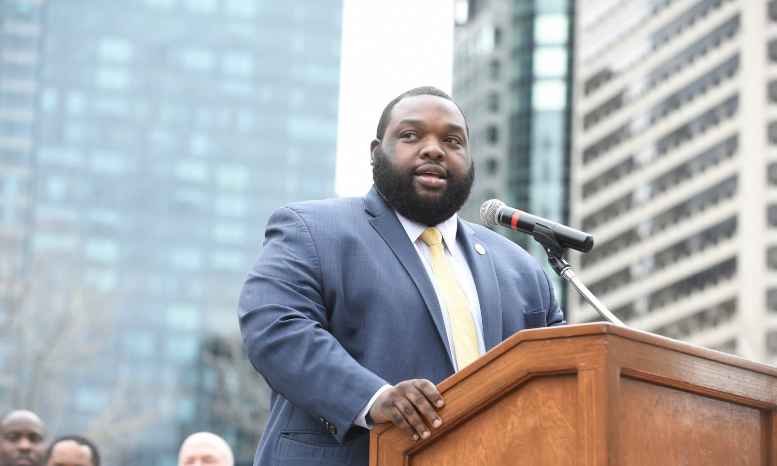Rep. Jordan A. Harris speaking at a press conference
