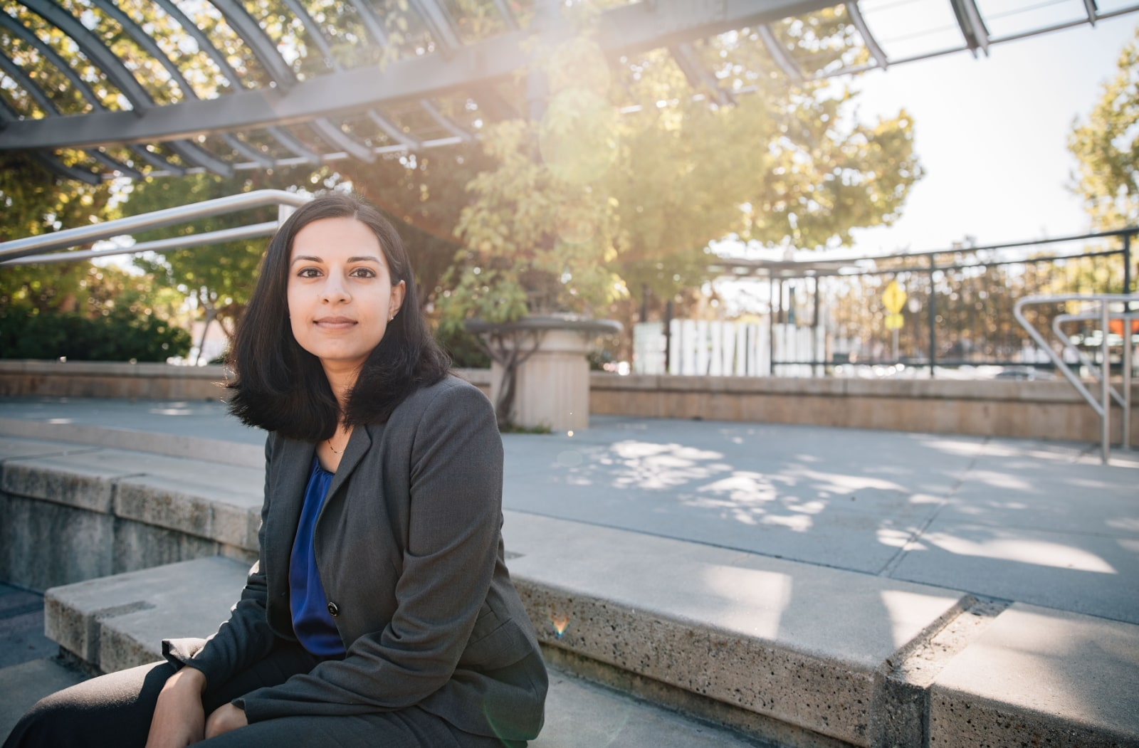 Nila Bala sitting on steps at a park