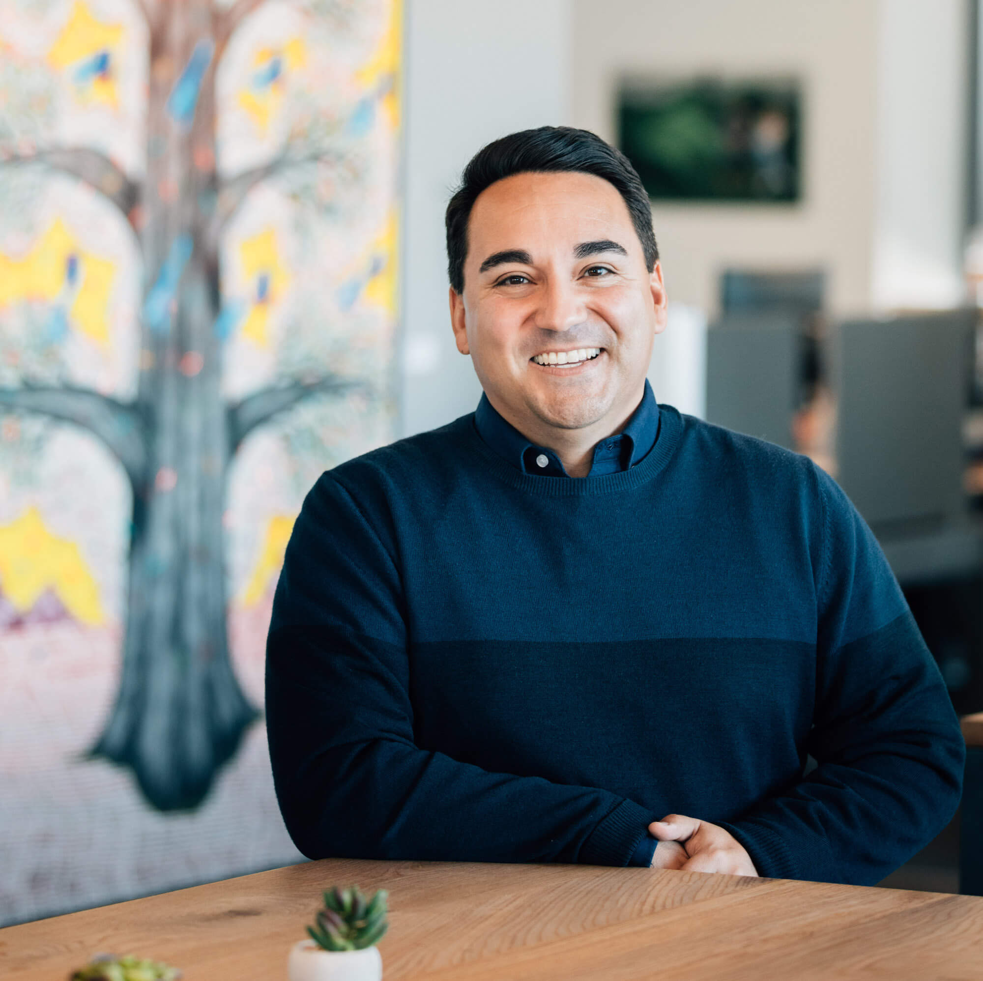 A portrait of Mike Troncoso, the Vice President and Head of the Justice & Opportunity Initiative at the Chan Zuckerberg Initiative