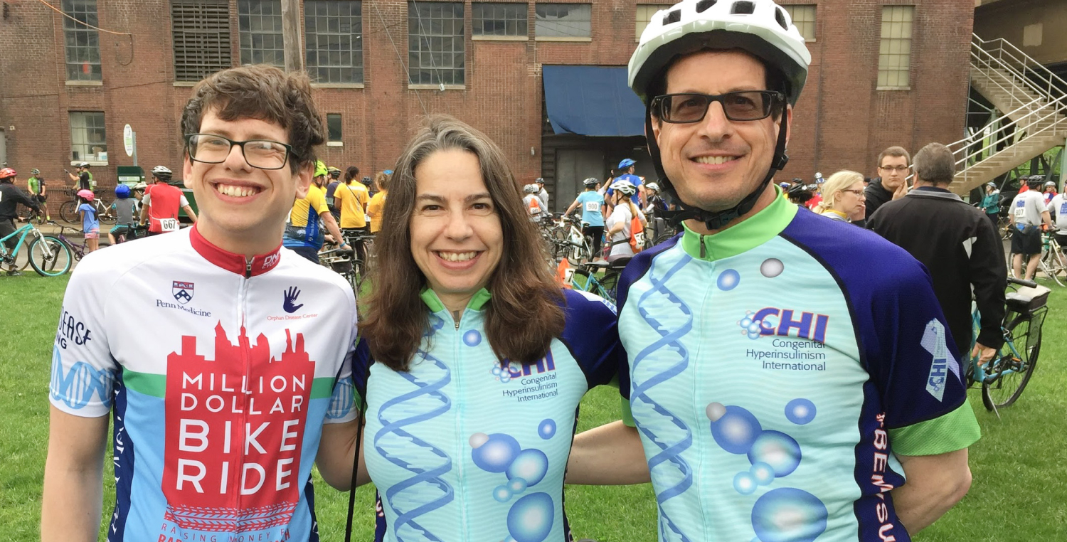 Photo of Julie Raskin of Congenital Hyperinsulinism International (center), her husband Mark Gross (right), and her son Benjamin Raskin-Gross (left) at a fundraiser bike ride
