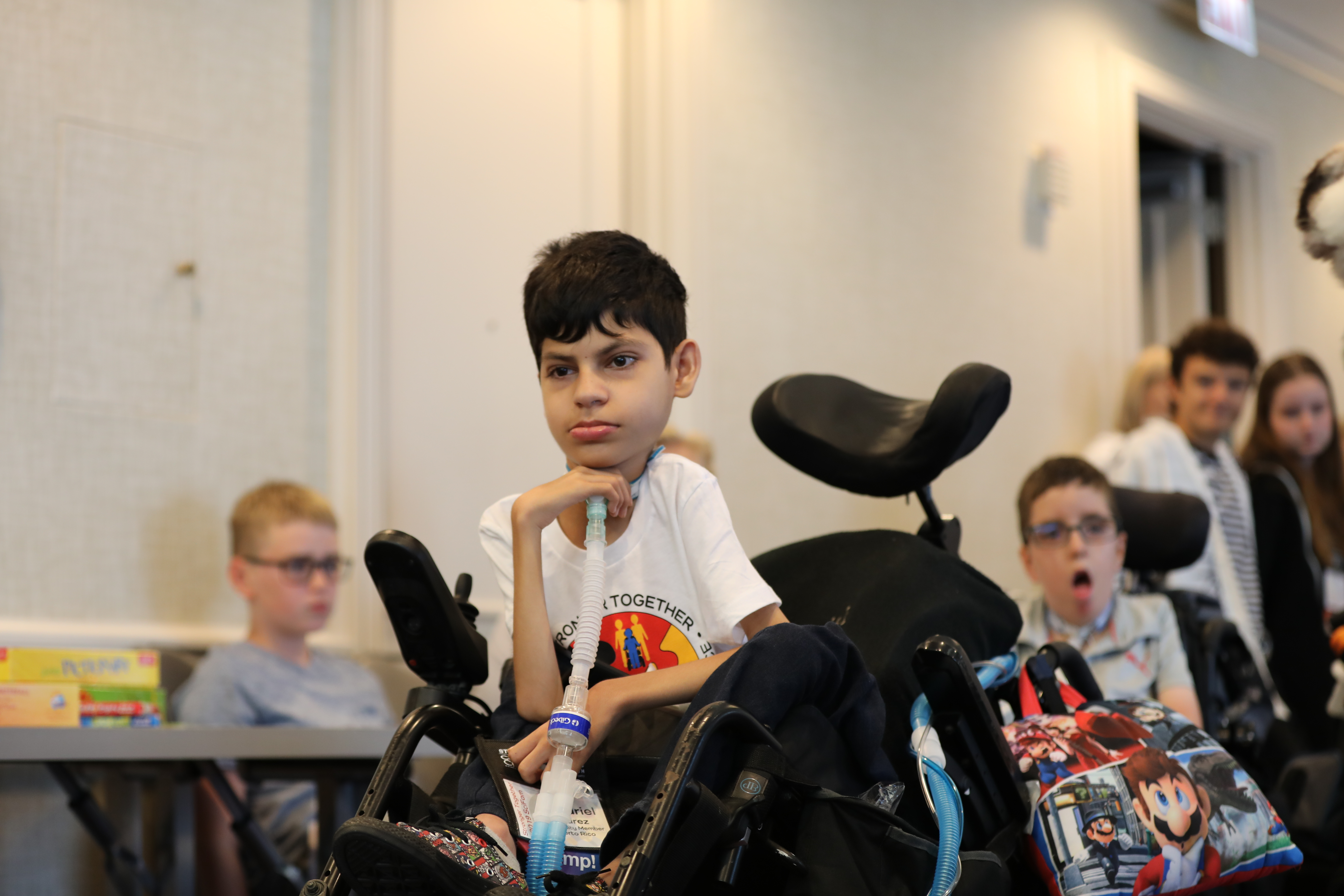 A young male child in a wheelchair