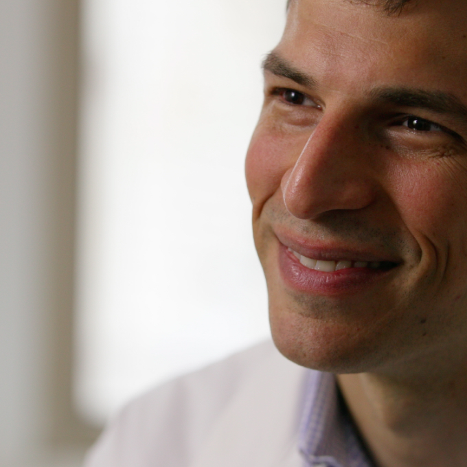 Close-up semi-profile of Castleman Disease Collaborative Network (CDCN) doctor smiling.