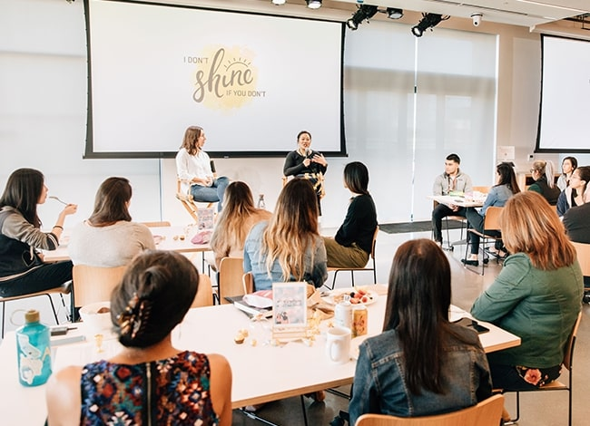CZI Co-founder and Co-CEO Priscilla Chan speaking to a group of attendees at a luncheon meeting (Diversity, Equity, & Inclusion).