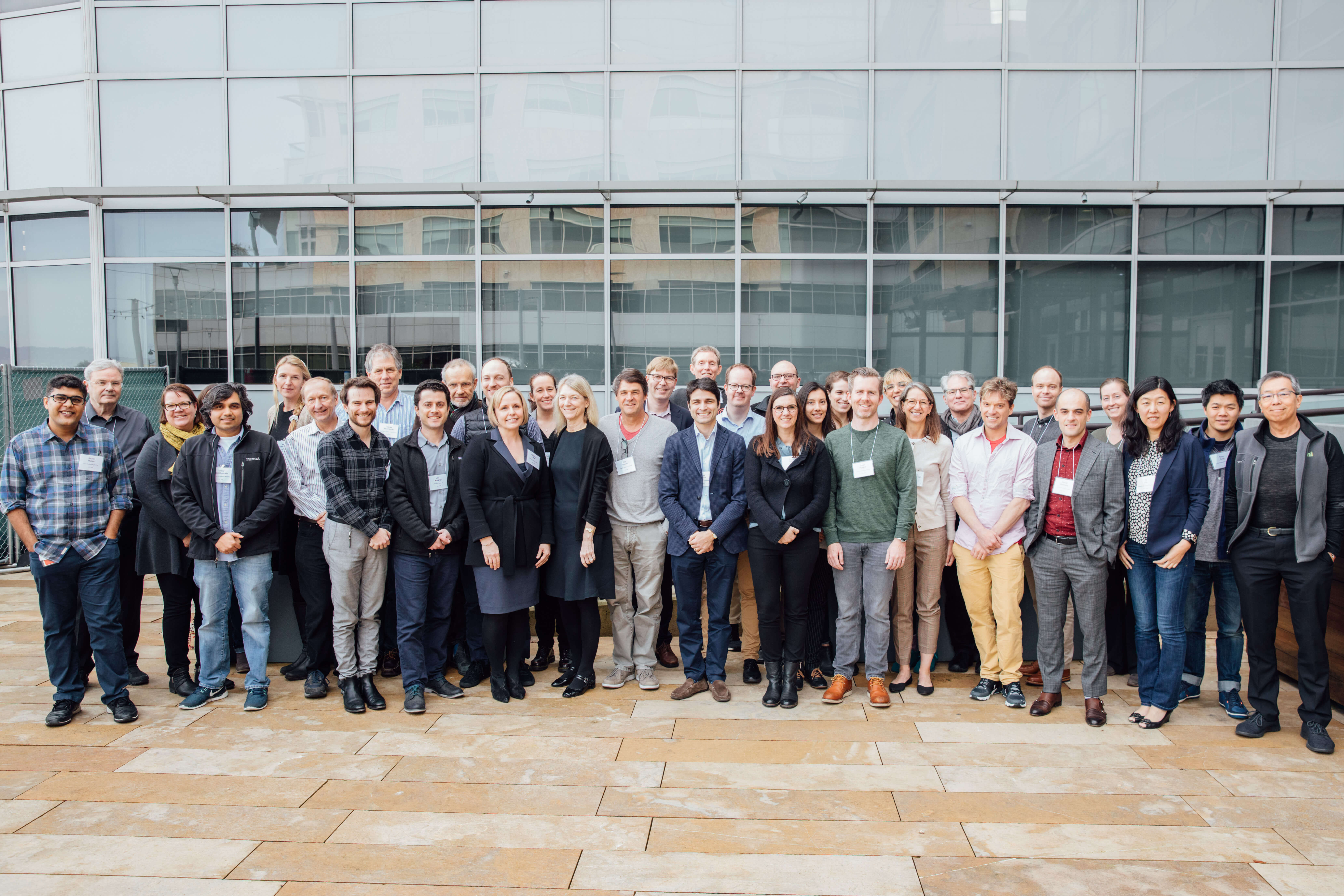 A group of attendees at the CZI Frontiers of Imaging workshop pose for a photo