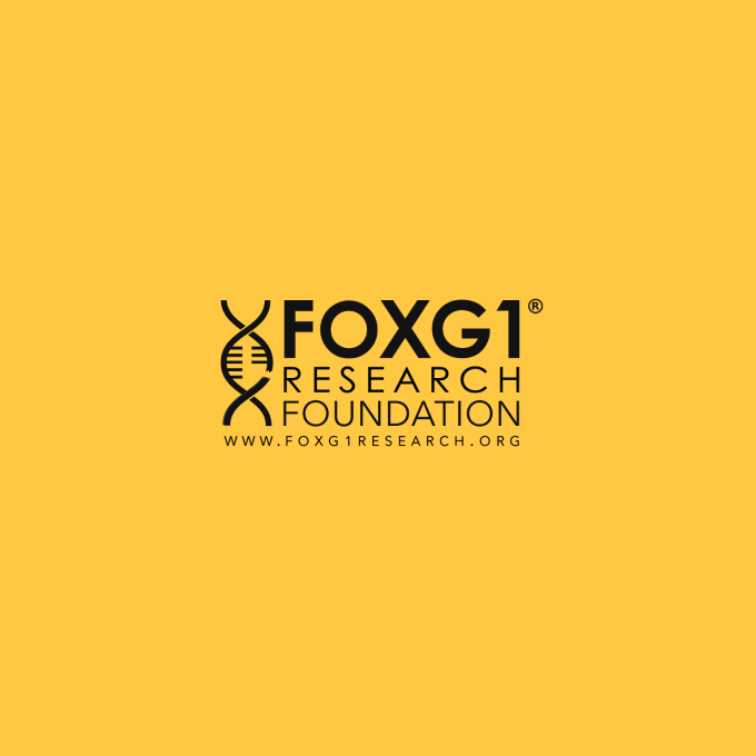 FOXG1 Research Foundation logo with stylized vertical DNA helix at left, black on yellow background.