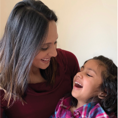 Science in Society thumbnail of INADcure Foundation president and co-founder holding her young daughter, who has the rare disease INAD, both smiling.