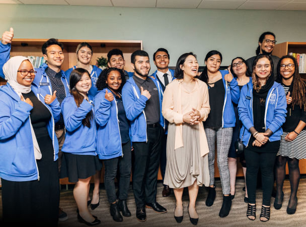 Priscilla Chan stands with a group of students from UC San Diego.