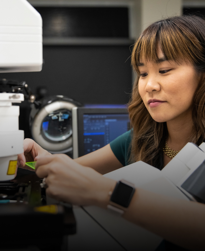 CZI Imaging Scientist Michelle S. Itano working at microscope at the University of North Carolina, Chapel Hill, Neuroscience Microscopy Core.
