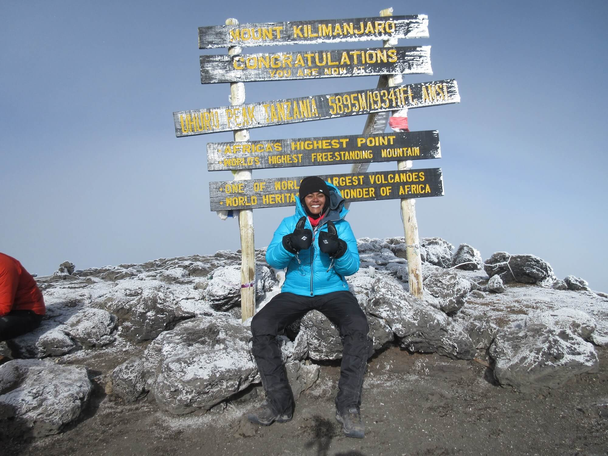 Lauren Turner smiles after reaching the top of Mount Kilimanjaro