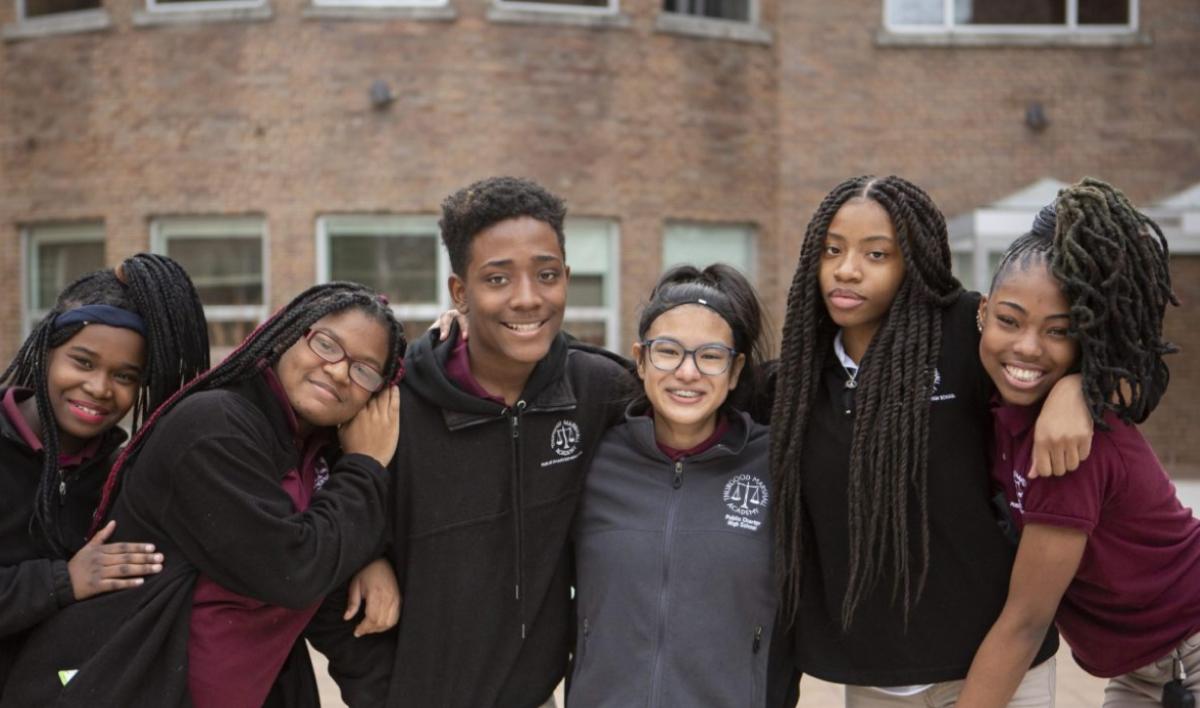 Six students pose together outside Thurgood Marshall Academy in Washington, D.C. (Whole Child, Education, CZI).