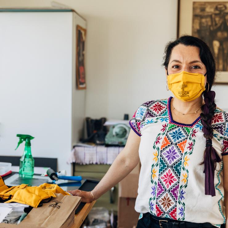 Woman board member from California nonprofit North Fair Oaks Community Alliance (NFOCA) indoors, wearing a mask - COVID-19 Response, CZI.