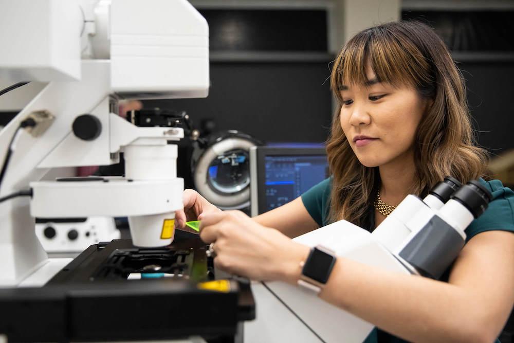 CZI Imaging Scientist working at microscope at the University of North Carolina, Chapel Hill, Neuroscience Microscopy Core (Technology Blog).